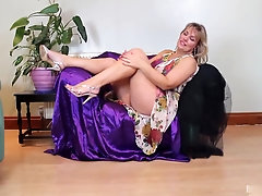 Blonde Milf with big tits and ass displays her goodies