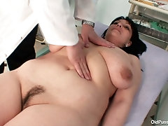 Mature brunette with big saggy tits in the gyno exam