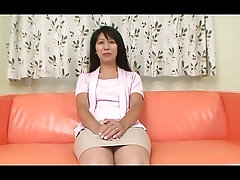 Hairy Japanese milf plays with her twat and bangs hard