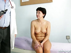 Kinky doctor thoroughly examines the short-haired patient's hairy mature pussy