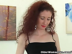 Slim redhead Milf masturbates in thigh-high leather boots all alone