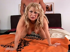 Blonde mature chick has kinky fuck session with young stud